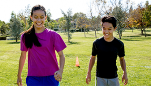 Invisalign Photo Teens playing Soccer