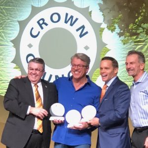 Dr. Edward White of White Family Dental receiving an award from the Crown Council